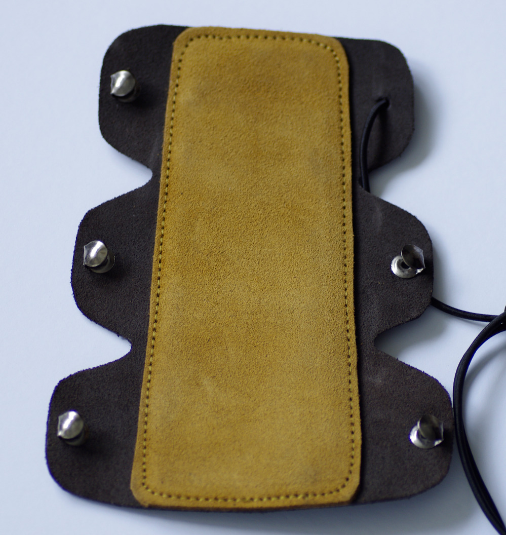 Bushman Cairn Bracer. Brown Panel. Metal Hook