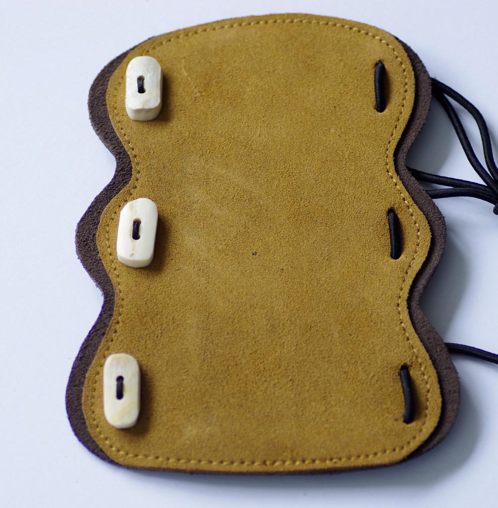 Bushman Dolmen bracer, suede leather, metal hook or bone button options.